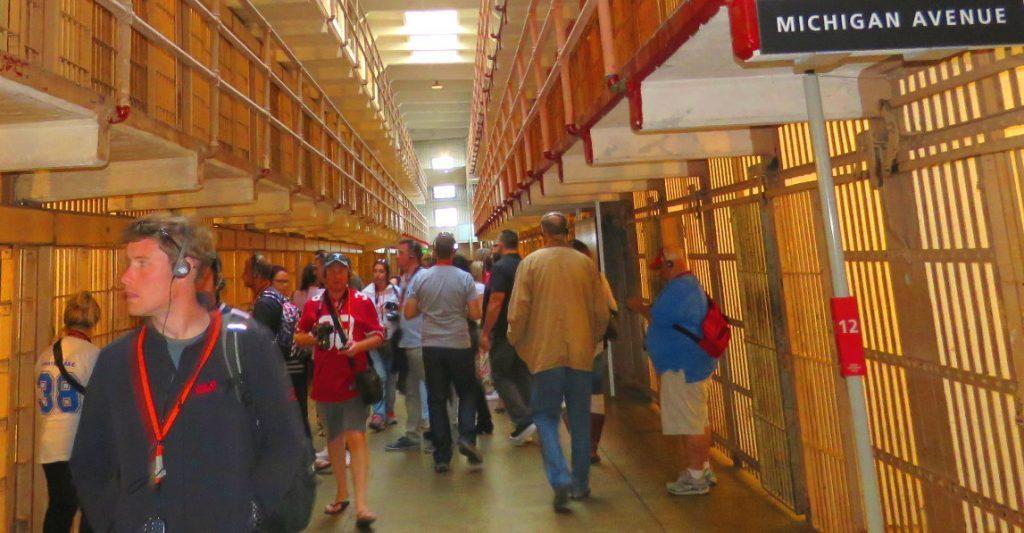 visit-alcatraz-prison-cell-block-tourists-walking-by-inmates-cells---x--x